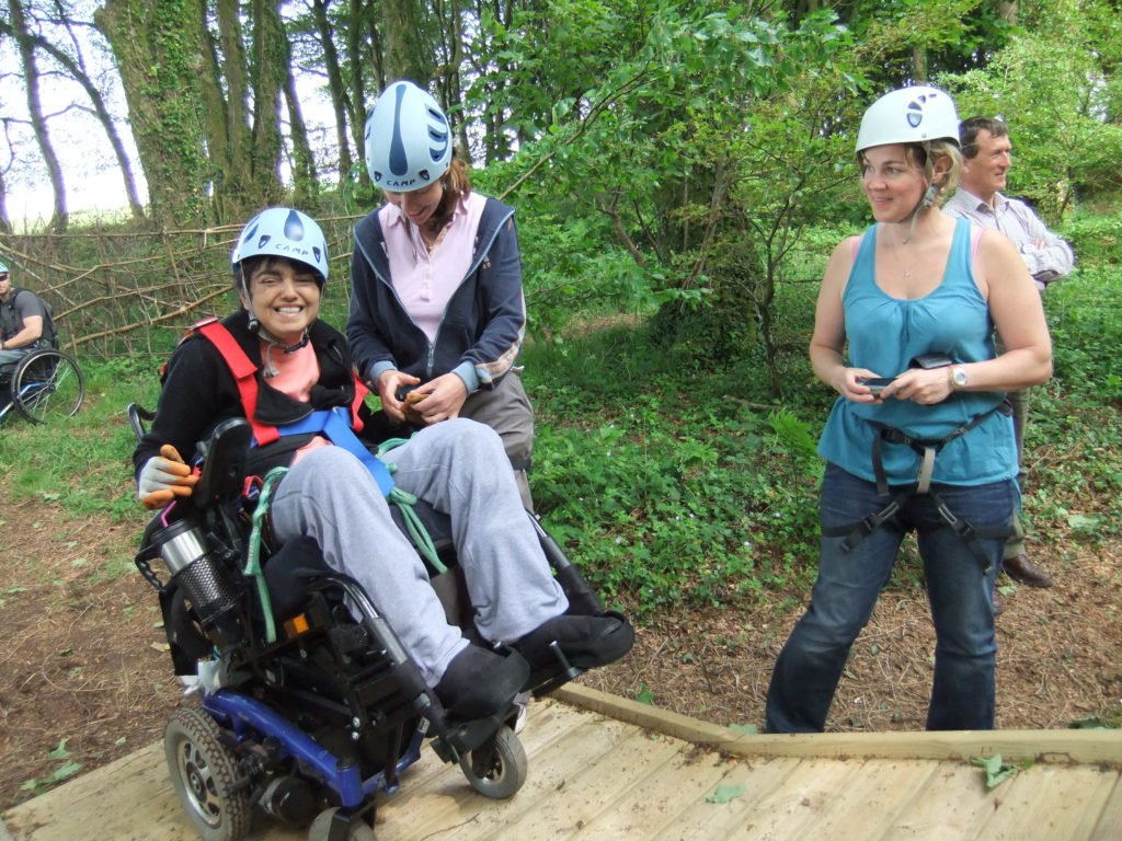 Wheelcahir user and two others in abseiling gear
