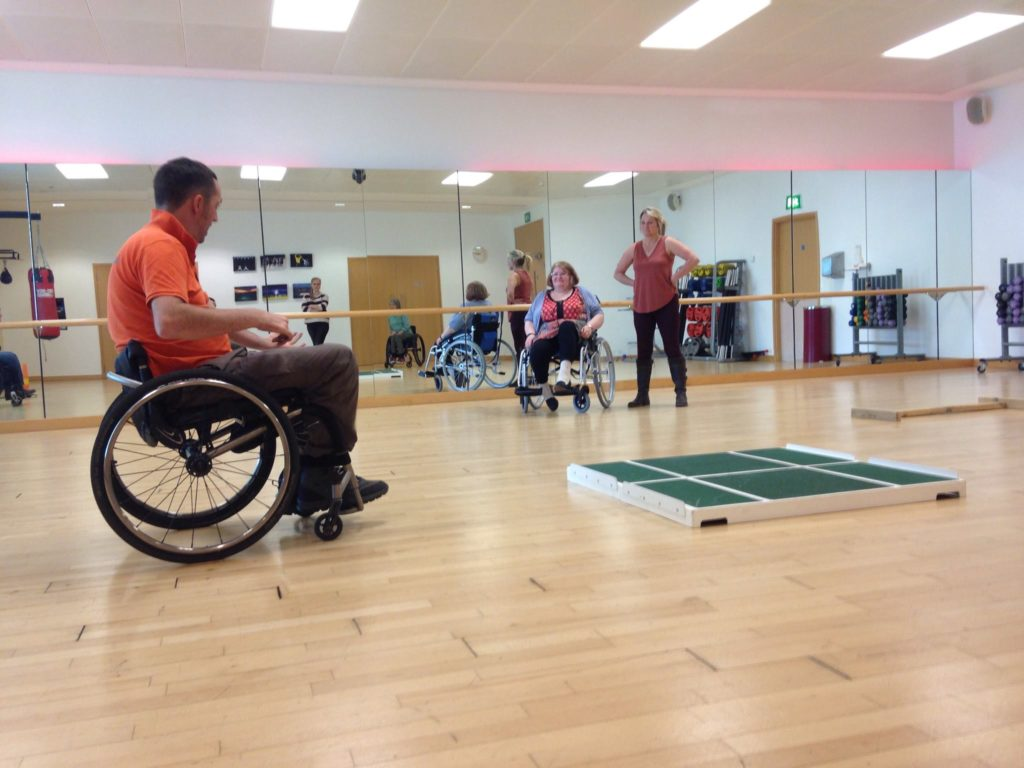 A photo of a wheelchair skills trainer and participant